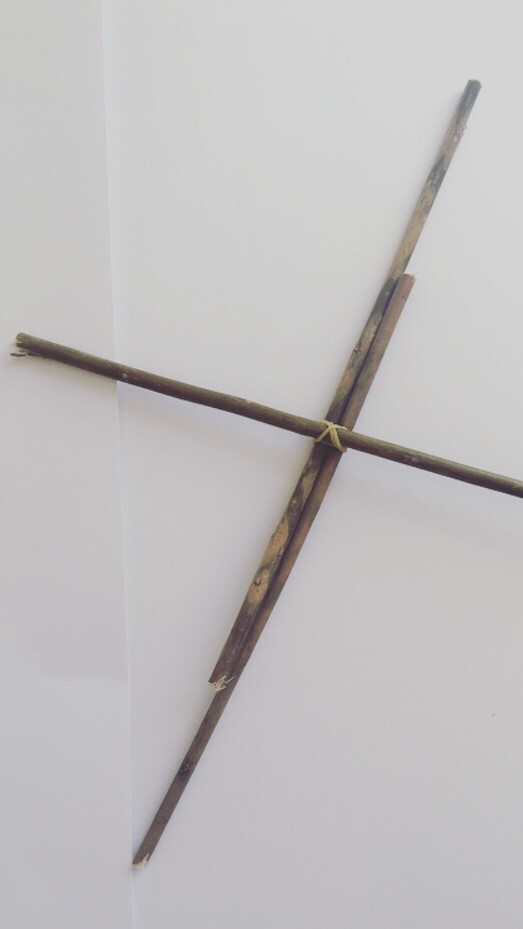 Step 5 - Put wooden sticks into a cross and secure together with elastic band